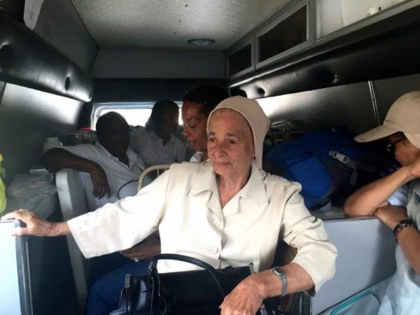 Sr. Concepción Rivera rides in the ambulance