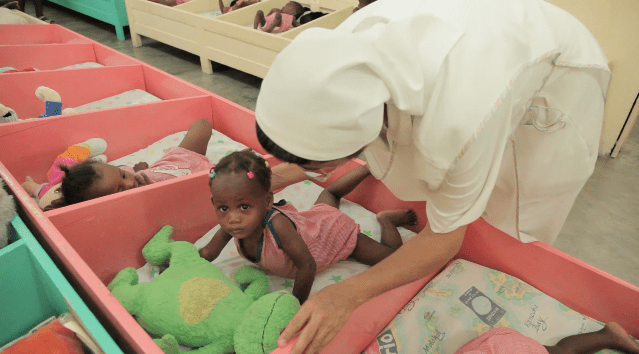 babies in cribs in Haiti