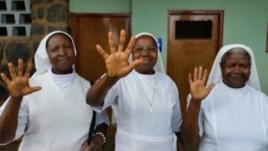 3 Sisters holding up 5 fingers