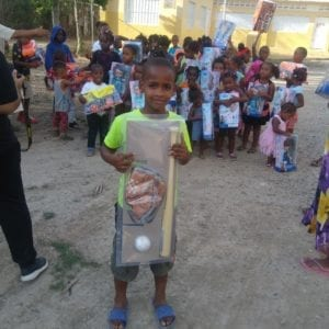 child holding toy at toy drive