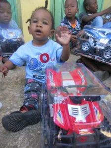 small boy with toy car