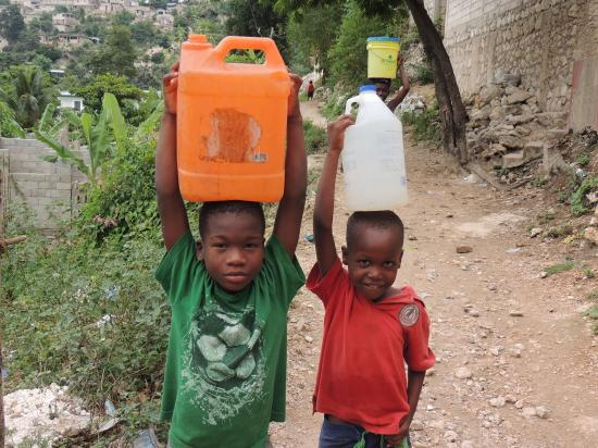 boys carrying drinking water